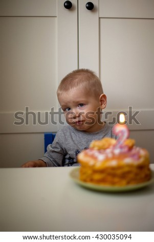 Blond young boy with birthday cake,selective focus  - stock photo