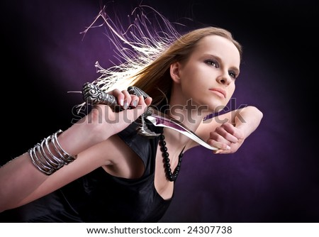 blond young girl holding old dagger