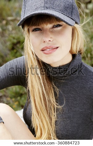 Blond young model in gray fashion, portrait