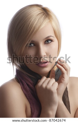 blond young woman in a close up portrait wearing a autumn color scarf looking at the camera isolated on white background