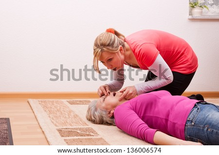 blond young woman ventilated senior - stock photo