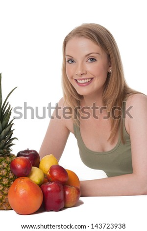 Blond young woman with assorted fruit - isolated on white