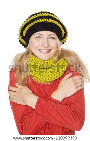 blond young woman with hat and wool scarf - stock photo