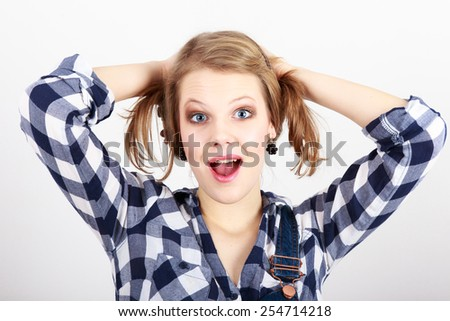 Blond young woman with her mouth open - stock photo