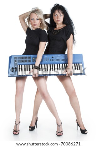 Blonde and brunette with electric piano on a white background