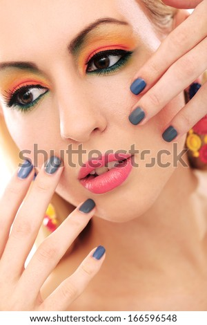 Blonde and really cute girl has colored makeup