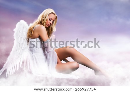 blonde angel on clouds - stock photo