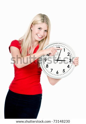Blonde beautiful girl with the clock isolated on white