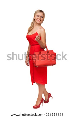 blonde beautiful woman in red dress holding big bag isolated on white - stock photo