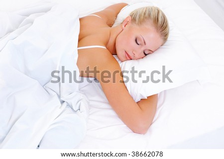Blonde beautiful woman sleeping in the bed - high-angle shoot