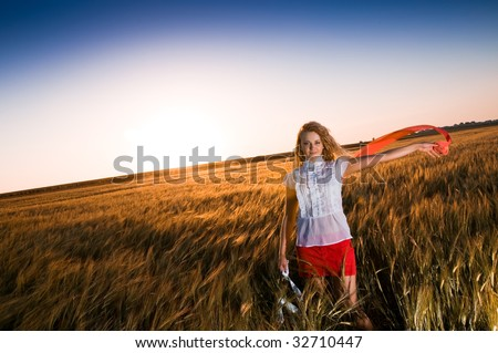 Blonde beauty in wheat field - stock photo