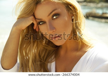 blonde beauty. outdoors shot. horizontal - stock photo