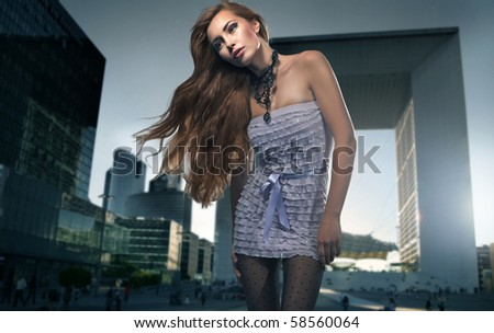 Blonde beauty over urban background - stock photo