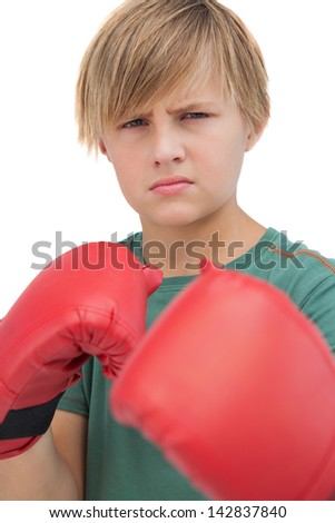 Blonde boy with boxing gloves on white background - stock photo