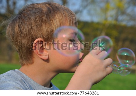 Blonde boy with soap bubbles.