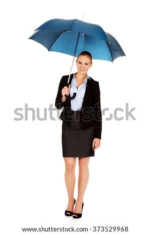 Blonde business woman holding an umbrella - stock photo