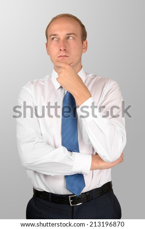 blonde businessman isolated on grey background