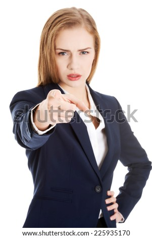 Blonde businesswoman pointing on you - stock photo