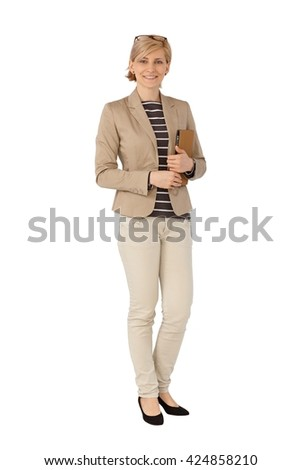 Blonde businesswoman standing over white background. Full size. - stock photo