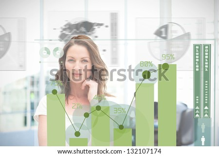 Blonde businesswoman using green chart interface with statistics - stock photo