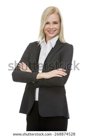 blonde businesswoman with her arms folded smiling at the camera - stock photo