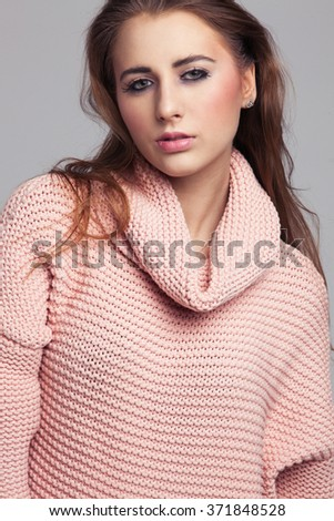 Blonde cheerful young woman. Beauty portrait, perfect makeup. Long chic elegant hair. Model tests. Cute girl in white. Sexy fashion woman. Close-up. Pink pullover. Bright. - stock photo