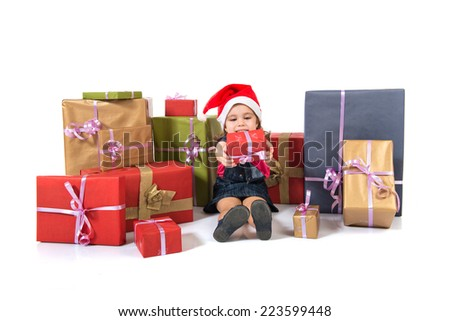 Blonde christmas kid around several presents