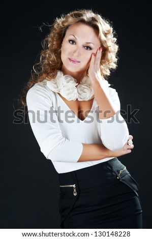 Blonde curly woman - stock photo