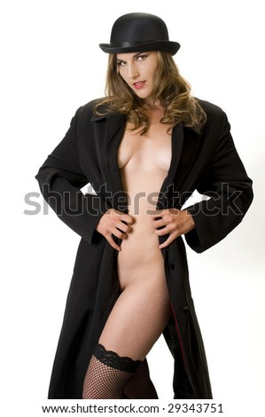 Blonde Fashion Model in Bowler Hat and Man's Raincoat.