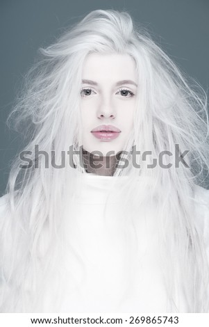 Blonde fashion woman in white coat pink  sexy lips portrait