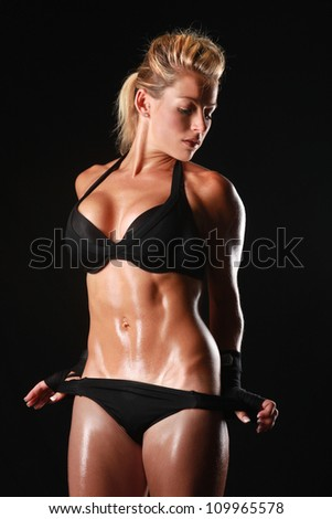 Blonde Female Bodybuilder With Beautiful Form - stock photo