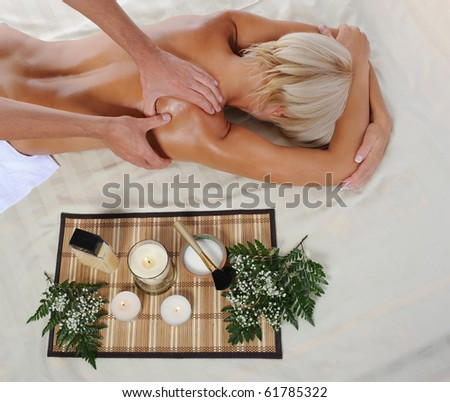 Blonde for massage in the spa salon - stock photo