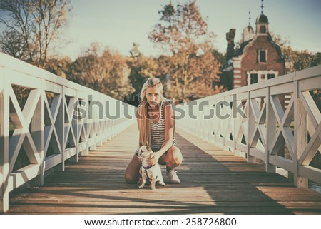 Blonde girl and chihuahua - stock photo