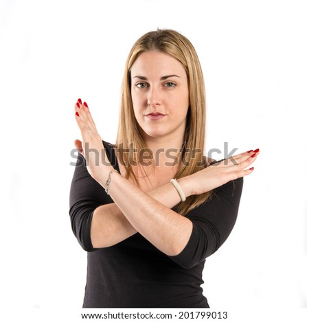 Blonde girl doing NO gesture over white background