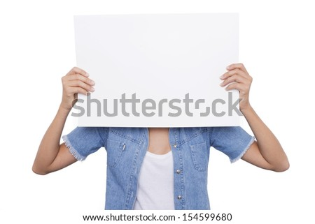 Blonde Girl holding a blank signboard front of her face - stock photo