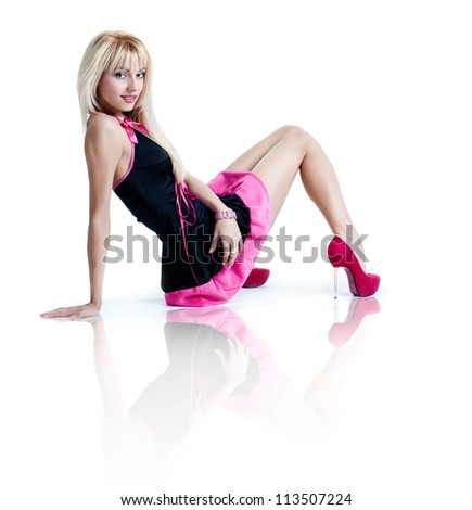 Blonde girl in a short dress - stock photo