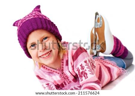 blonde girl lying on ice in skates - stock photo