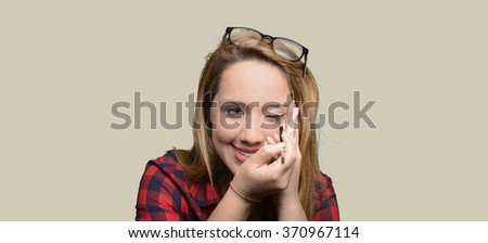 Blonde girl make-up her face - stock photo