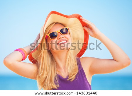 Blonde girl on the beach in spring time. - stock photo