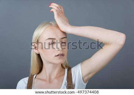 blonde girl put her hand to her forehead as I forgot about