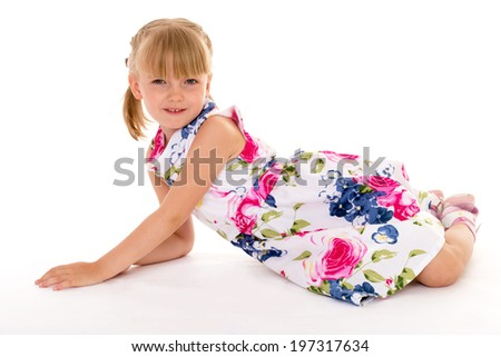 Blonde girl summer dress lying on a white background
