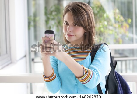 blonde girl using her cellular phone