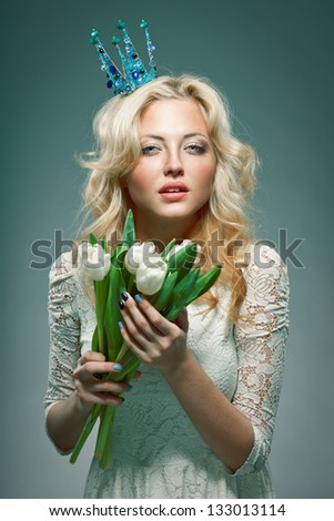 blonde girl wearing princess crown holding white tulips - stock photo