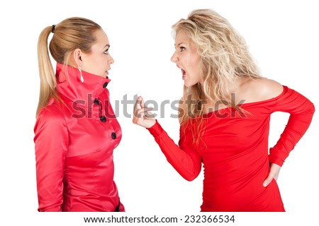 Blonde girl whispering to a friend against white background. Two young girlfriends talking. Emotional talking