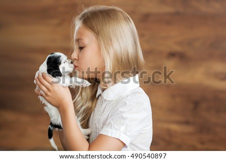 Blonde girl with a puppy cocker spaniel