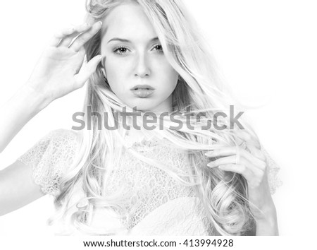 Blonde girl with flying hair