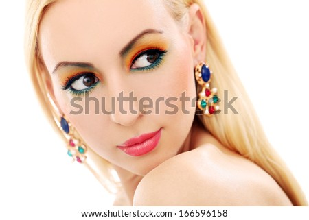 Blonde girl with jewelry has colored makeup