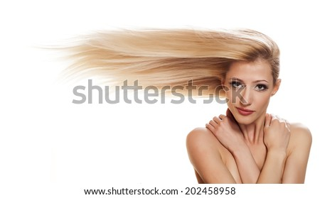 blonde girl with long hair in horizontal to the side - stock photo
