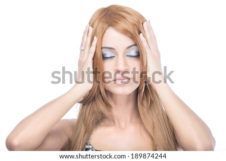 blonde girl with makeup holds on her head - stock photo
