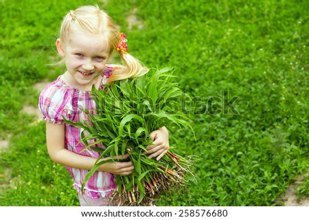 blonde girl with saplings at the outdoors - stock photo